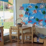 daycare room decorated with children's crafts