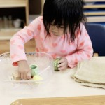 young girl playing with objects during sensory play time